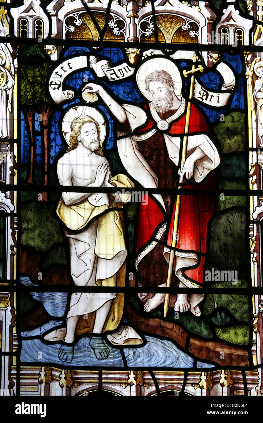 stained glass window depicting the baptism of jesus christ by john
