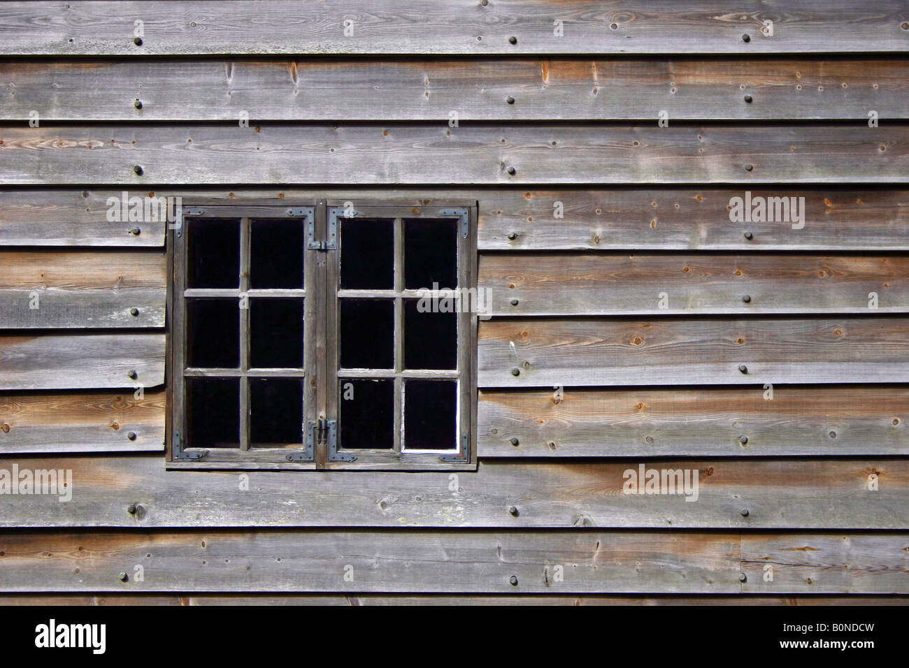 Traditional window panes in an old wooden house at Stend Fana