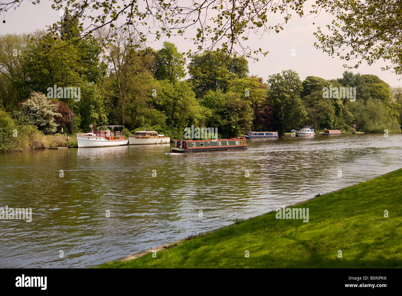 A Canal Barge Sailing Past Pleasure Boats On The River Thames In Berkshire Viewed From Windsor Home Park Castle
