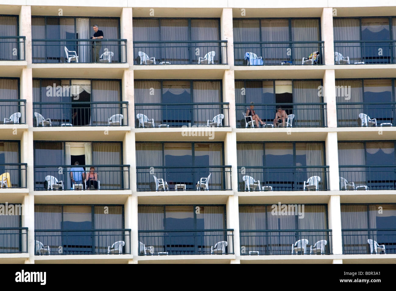 People on balconies of hotel rooms at galveston beach in for Hotels with balconies