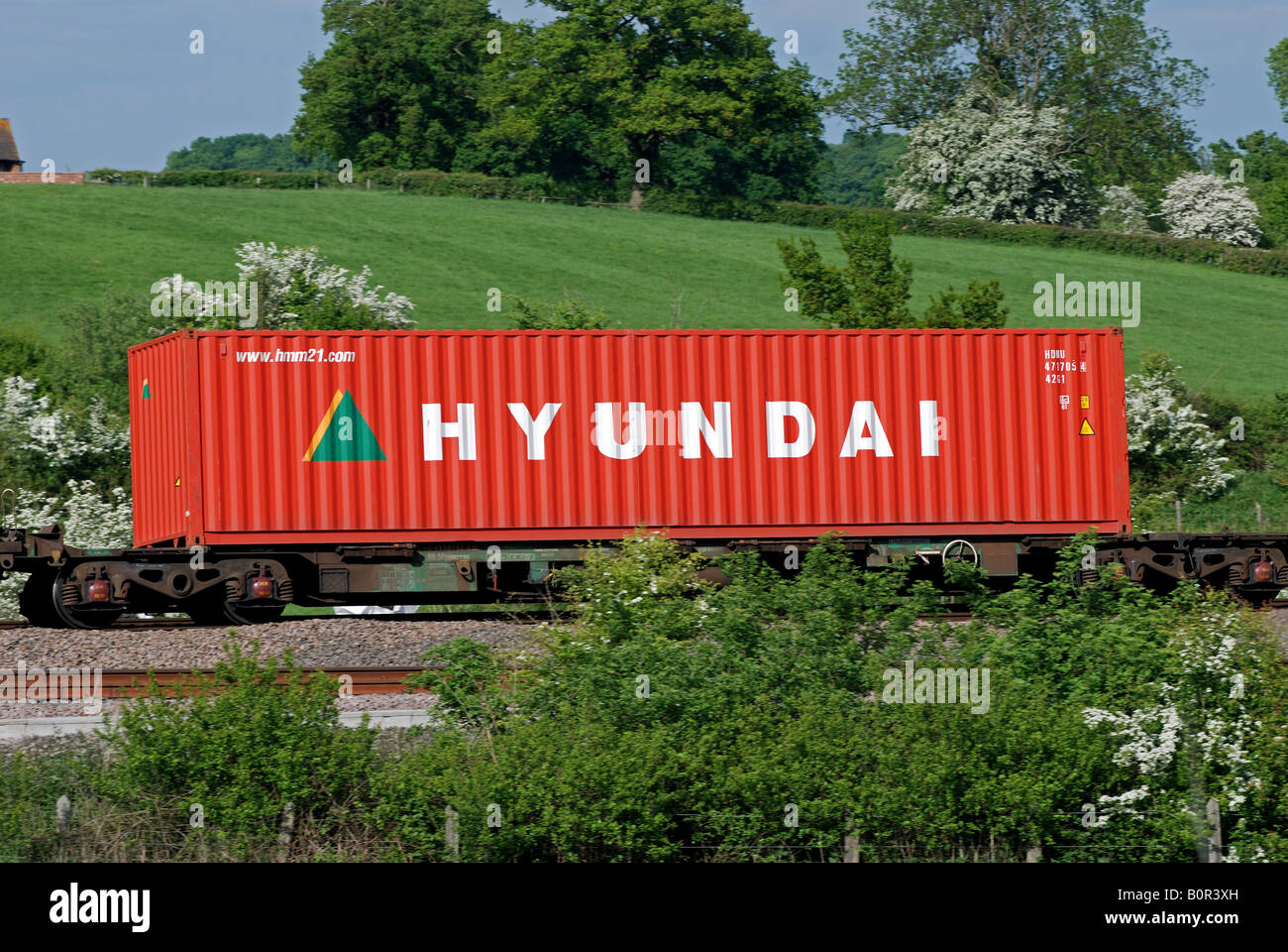 Hyundai Shipping Container On Train Uk Stock Photo