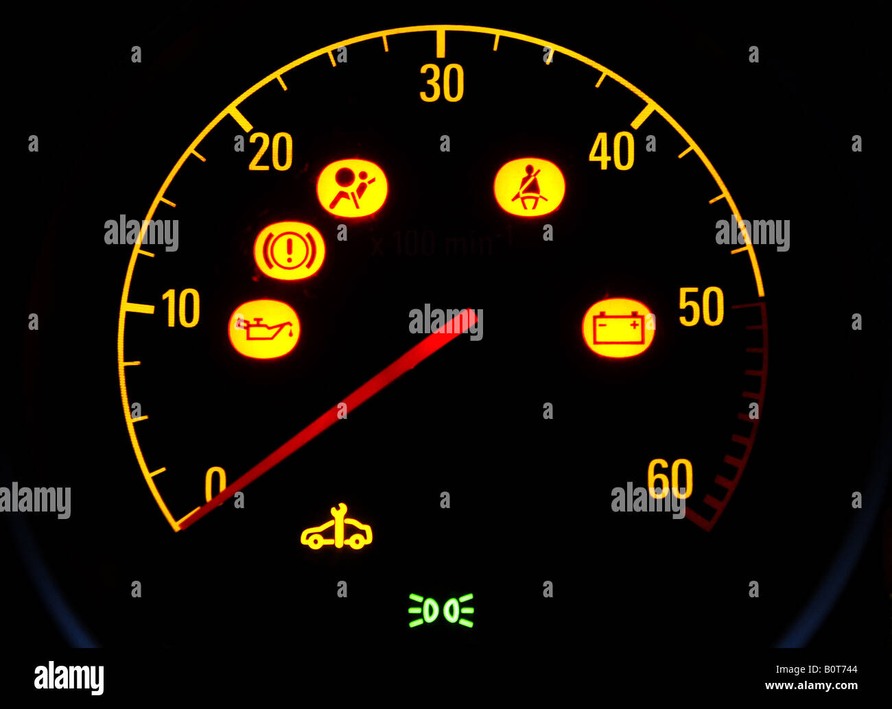 Car rev counter with illuminated warning symbolsuk stock photo car rev counter with illuminated warning symbolsuk buycottarizona