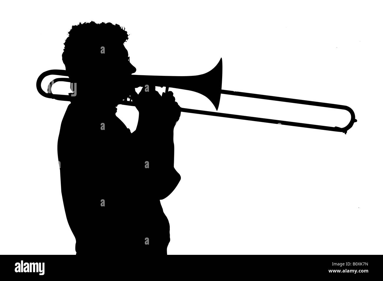 Silhouette of a man playing the trombone Stock Photo ...