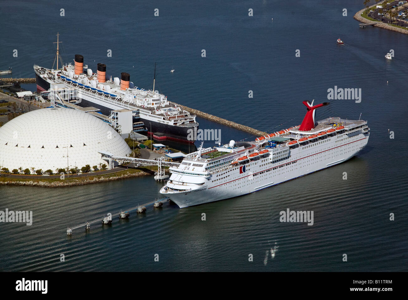 Aerial Above Queen Mary And Carnival Cruise Ship Paradise Vessel - Long beach cruise ship schedule