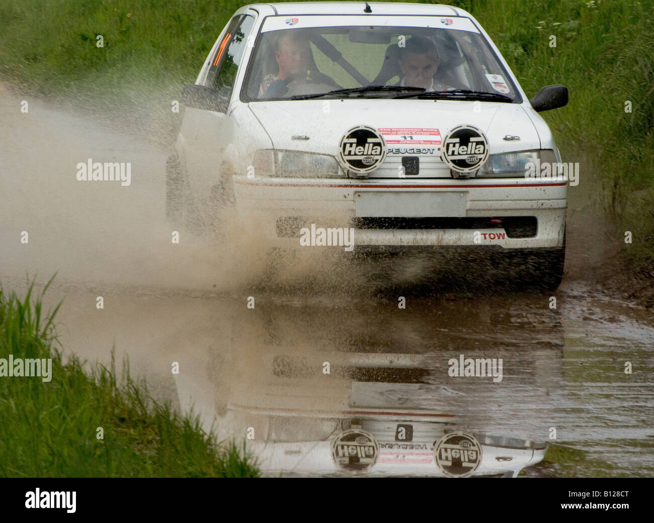 Rally car making a splash Stock Photo, Royalty Free Image ...