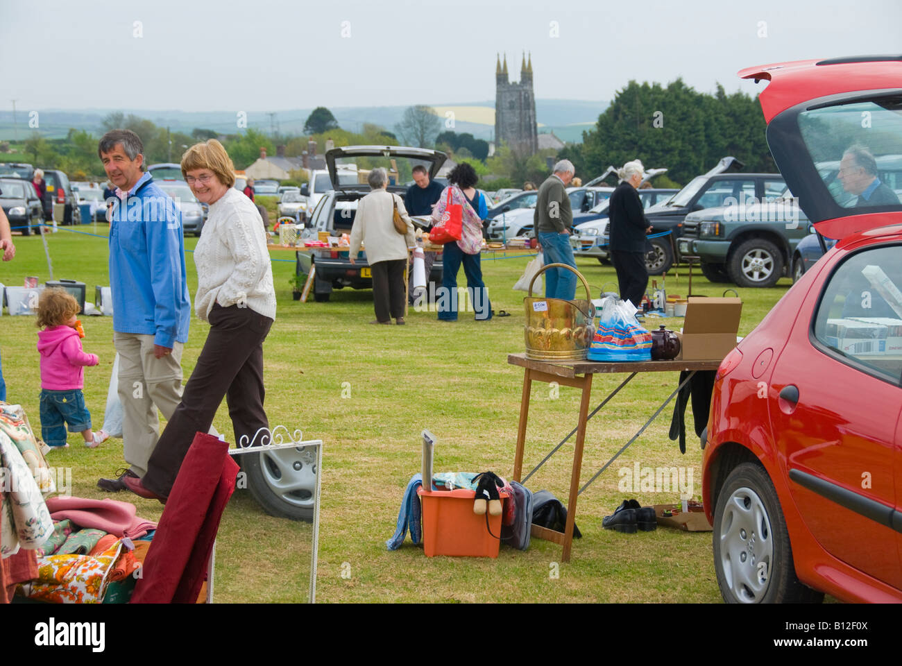 People at a car boot sale in england stock image