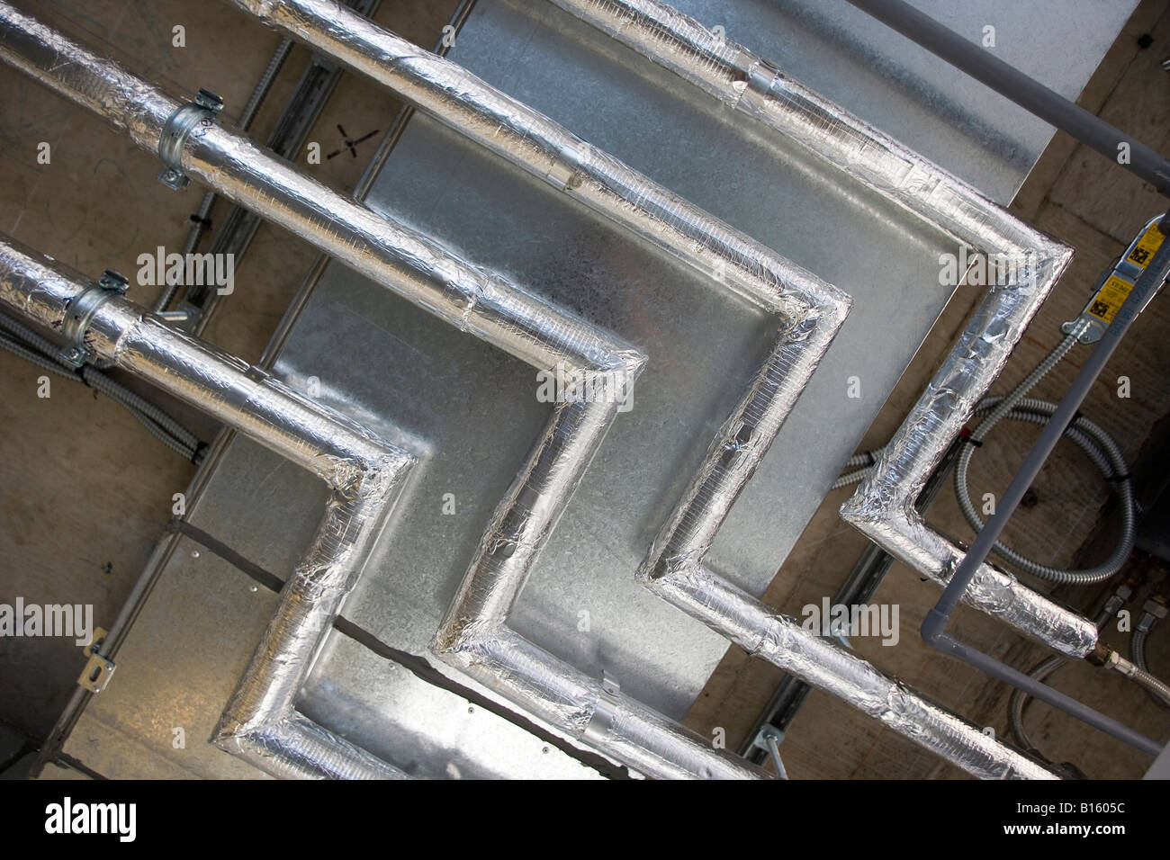 air conditioning pipes in a newly constructed office building stock
