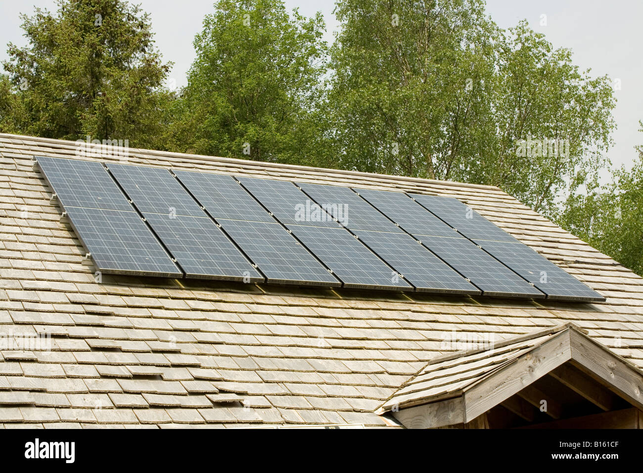 Seven Solar PV Panels On Wood Shingle Roof Centre For Alternative  Technology Machynlleth Powys Wales UK