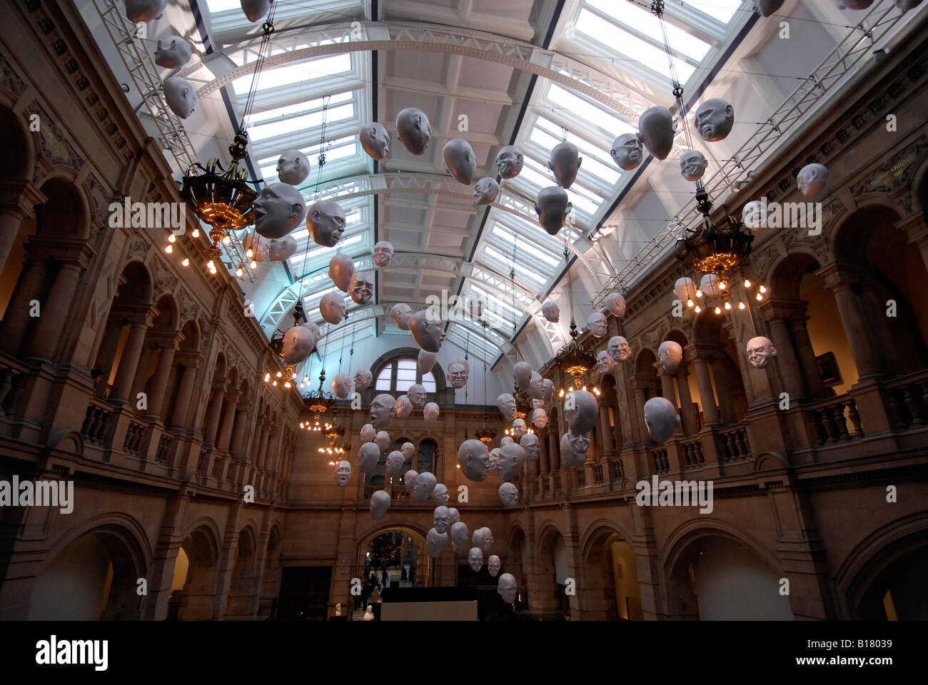masks hanging from the ceiling of the kelvingrove museum and art