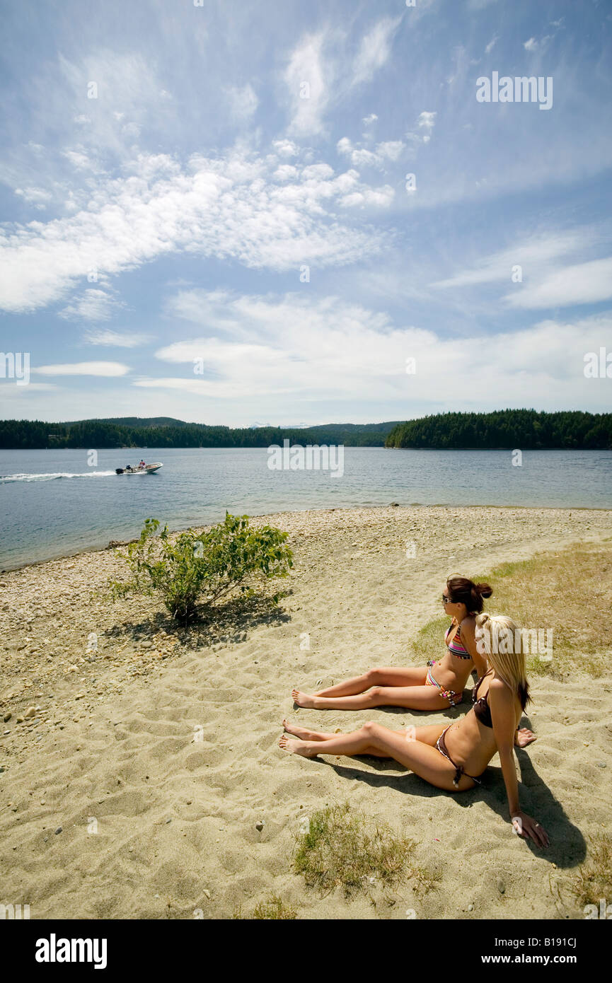 Stock Photo  Young Women On The Beach At Mcivor Lake Campbell River,  Vancouver Island, British Columbia, Canada
