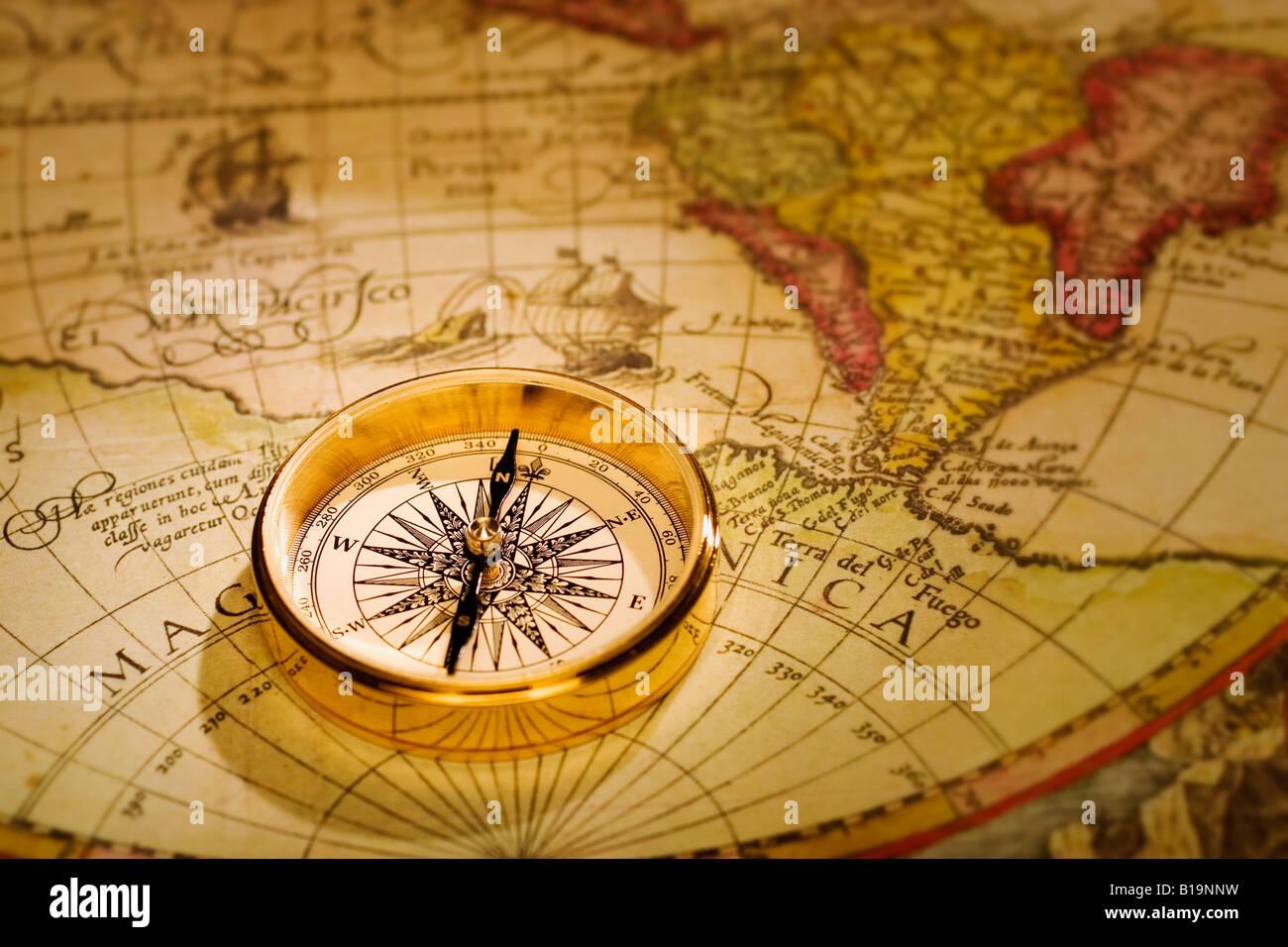 An antique gold compass set upon a sixteenth century map of the an antique gold compass set upon a sixteenth century map of the world gumiabroncs Images
