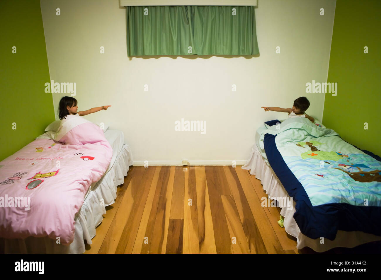 Brother And Sister At Bedtime In A Shared Bedroom Boy Aged Six Girl Stock Photo Royalty Free