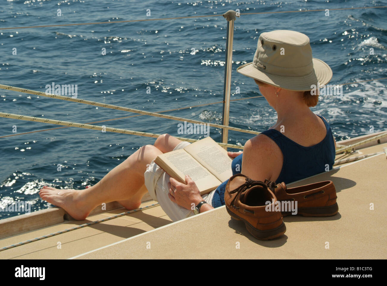 Worksheet Reading Boat woman reading book on boat stock photo royalty free image boat