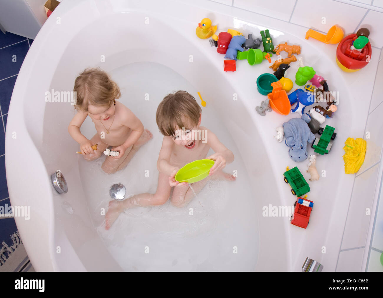 Little Children Playing In Bath Tub Stock Photo Royalty