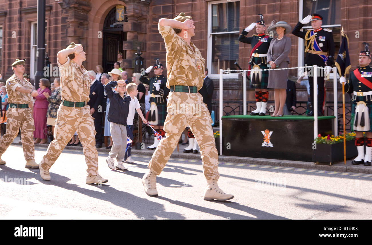 military soldiers of the royal regiment of scotland saluting as