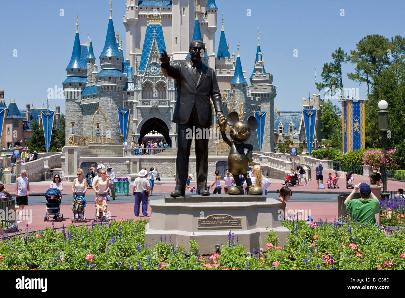 Stock photo walt disney and mickey mouse bronze statues at walt disney world resort in orlando florida