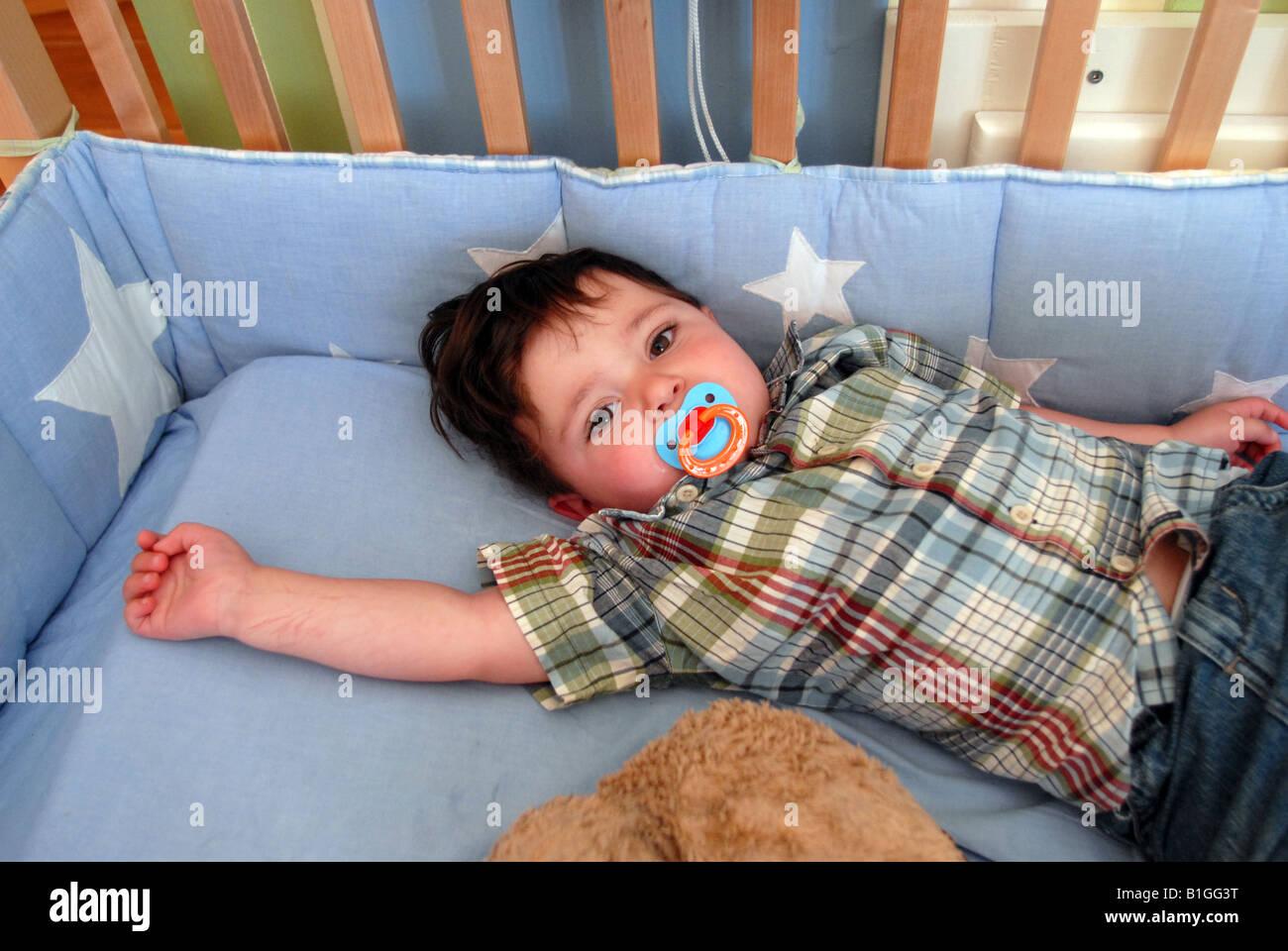 One And 1 2 Year Old Hispanic American Boy In His Crib