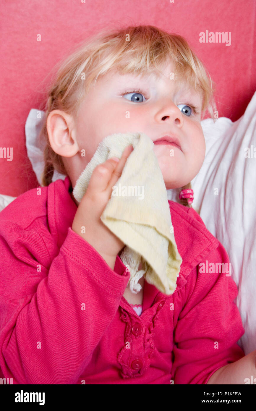 Little Girl Washing Hands And Face With Washcloth Stock