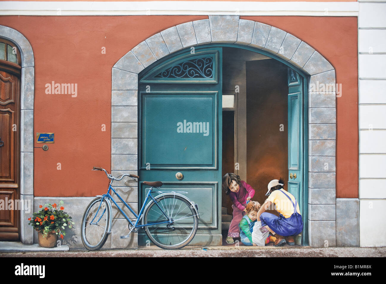 Trompe l oeil wall painting on building facade at for Mural on building
