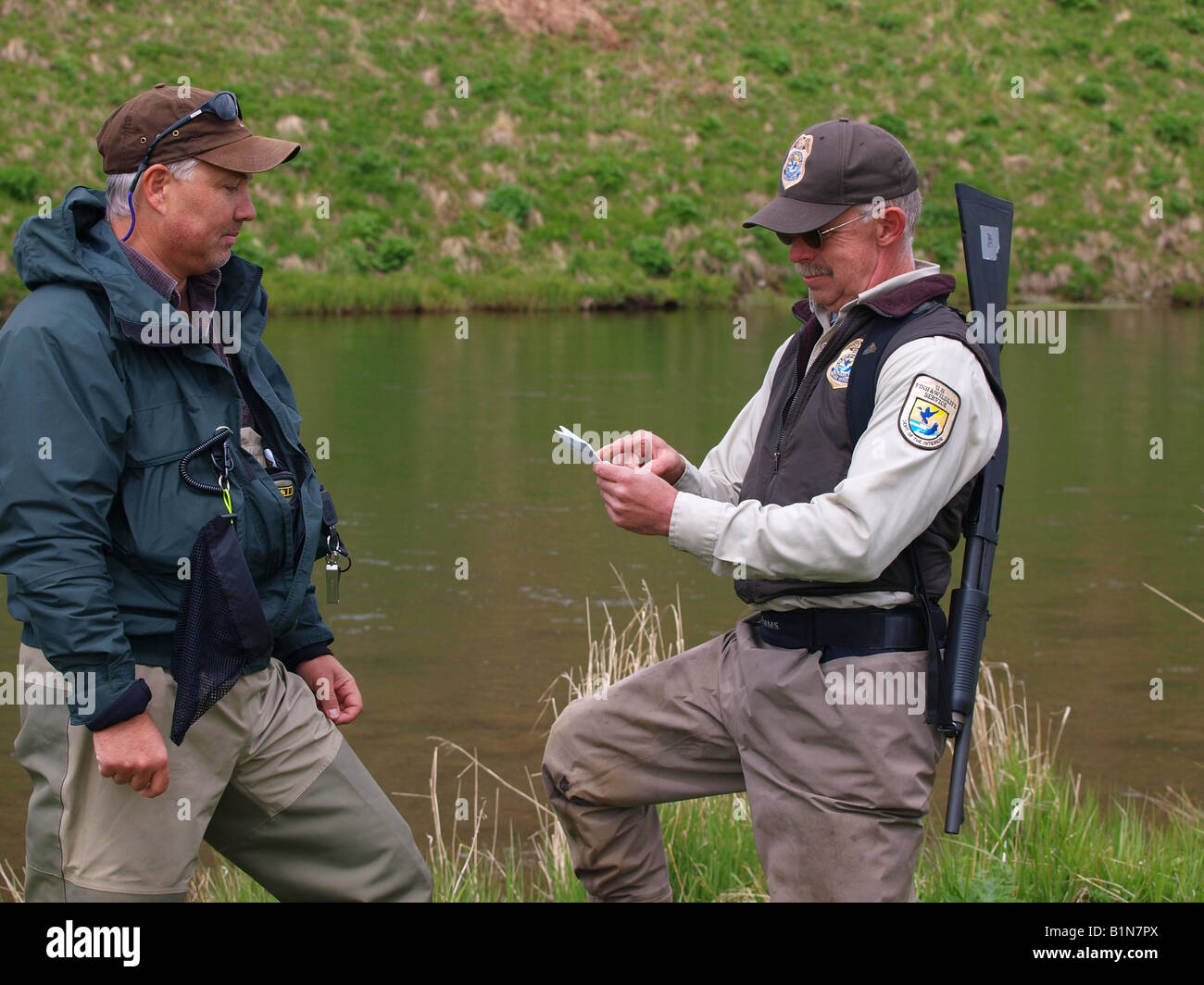 Us federal fish and wildlife officer checks fisherman 39 s for Us fish and wildlife
