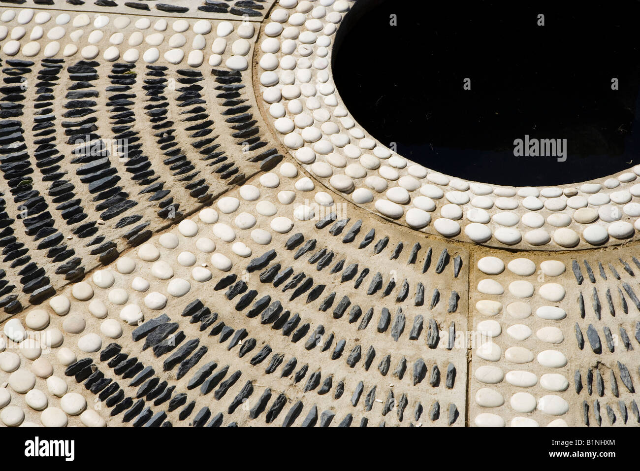 Stock Photo   Circular Patio Inlaid With Pebbles And Stones
