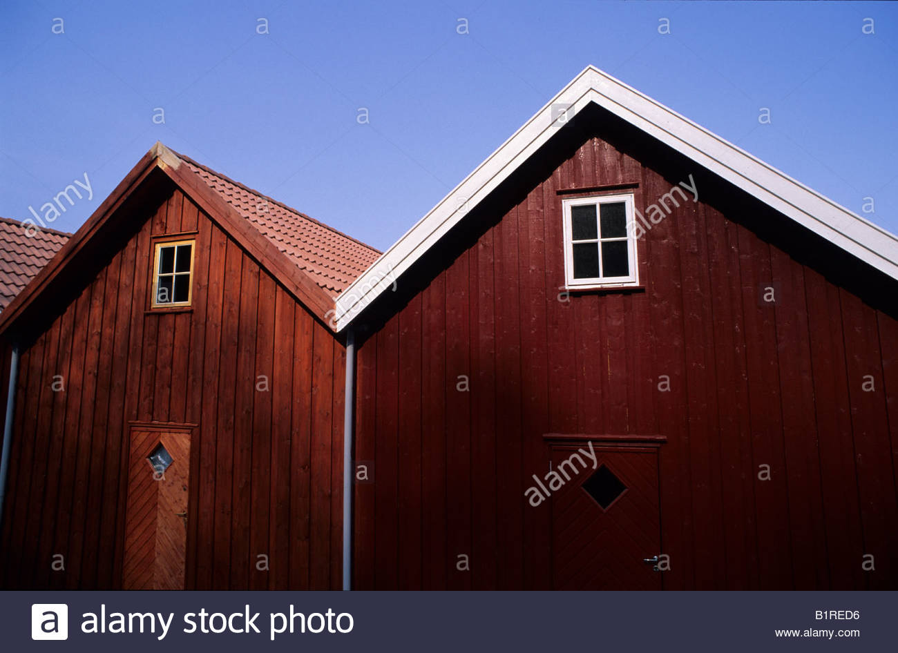 Boat shed in the traditional norwegian style of red wooden for Norway wooden houses