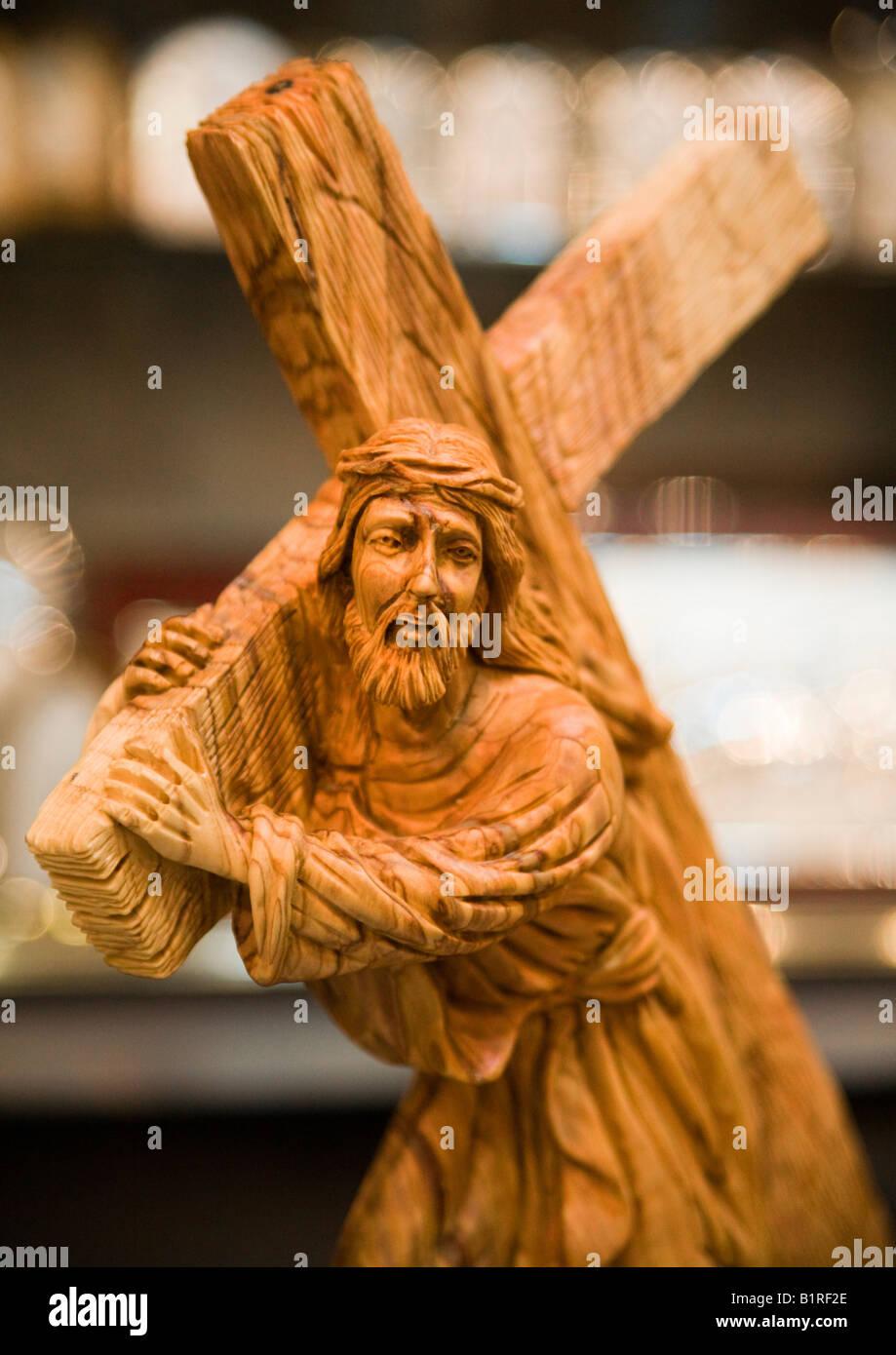 Wood carving of jesus carrying his cross bethlehem