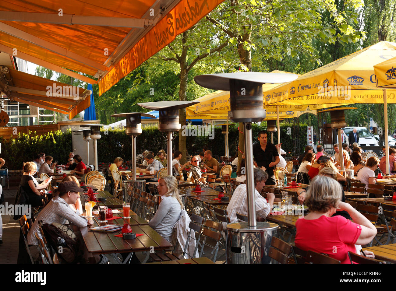 Stock Photo   Terrace Of A Restaurant With Patio Heaters, Also Called A  Mushroom Or Umbrella Heaters, On Leopoldstrasse Street, Schwabing, Mu