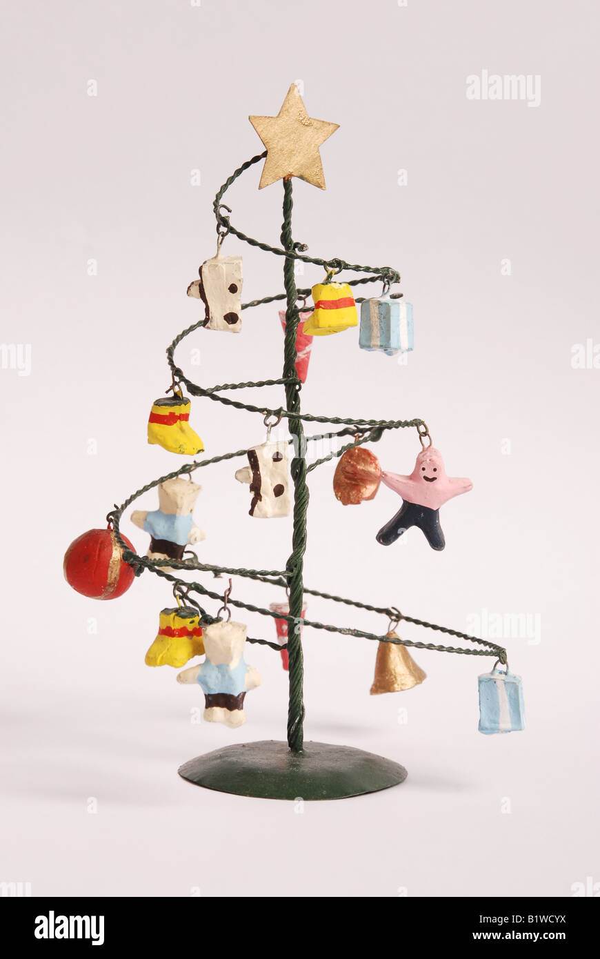 Modern funky Christmas tree made from metal with ceramic baubles ...