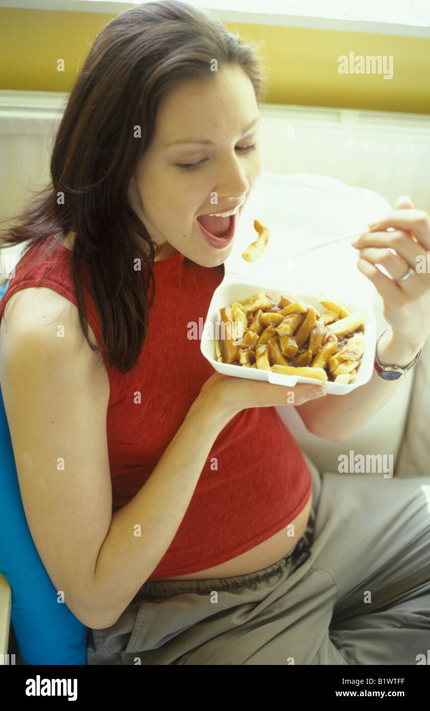 Pregnant woman eating fish and chips stock photo royalty for Eating fish while pregnant