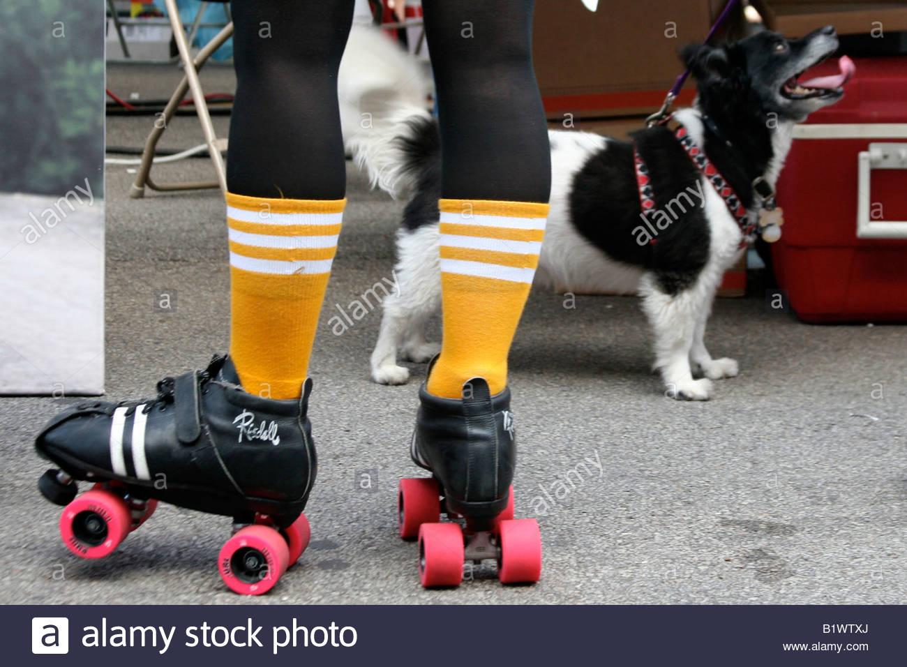 Roller skates in the 70s - Rollerskating Roller Skates 80 S 70 S Legs Dog Stock Image