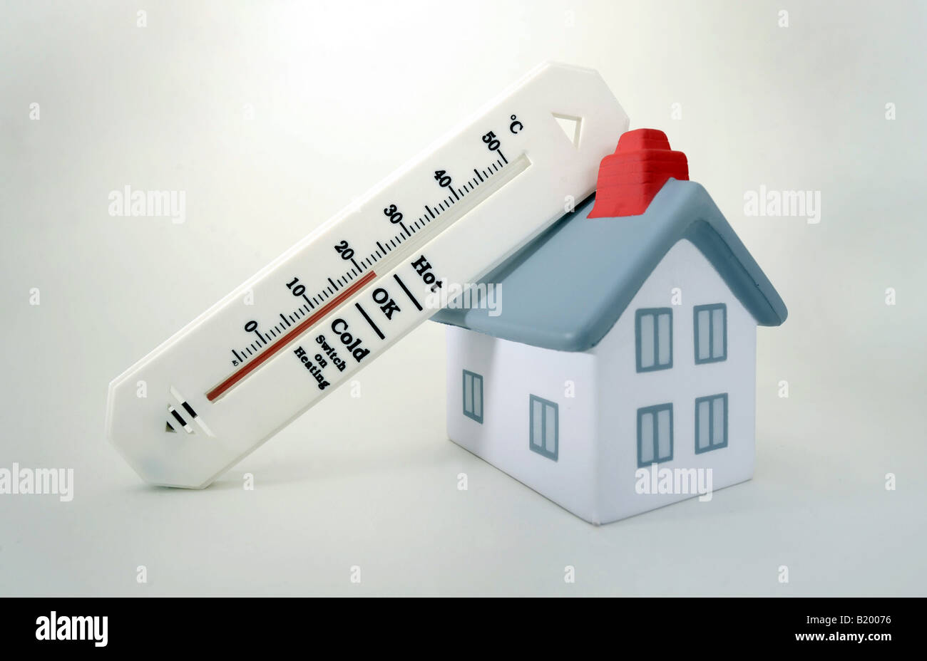 HOUSE WITH THERMOMETER SHOWING 20 DEGREES CELCIUS ROOM TEMPERATURE