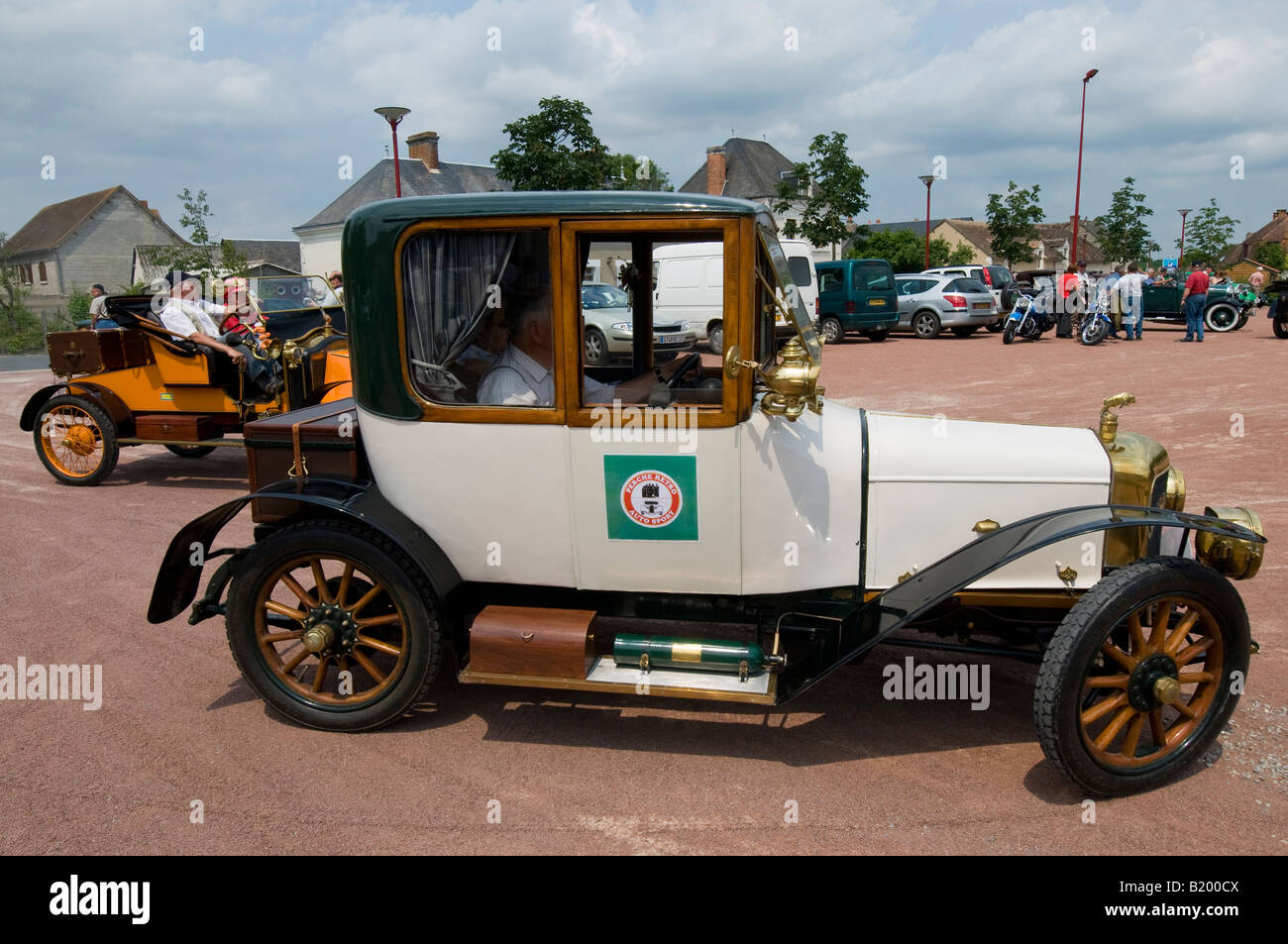 Vintage automobile with owner - classic car rally, France Stock ...