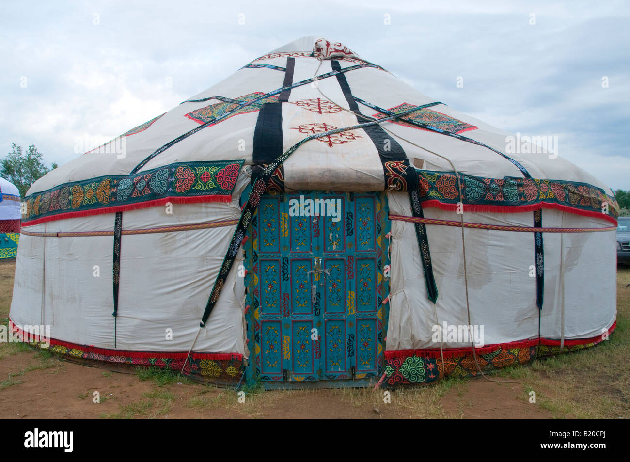 A traditional portable Yurt round tent covered with skins or felt and used as a dwelling by nomads in Central Asia & A traditional portable Yurt round tent covered with skins or felt ...
