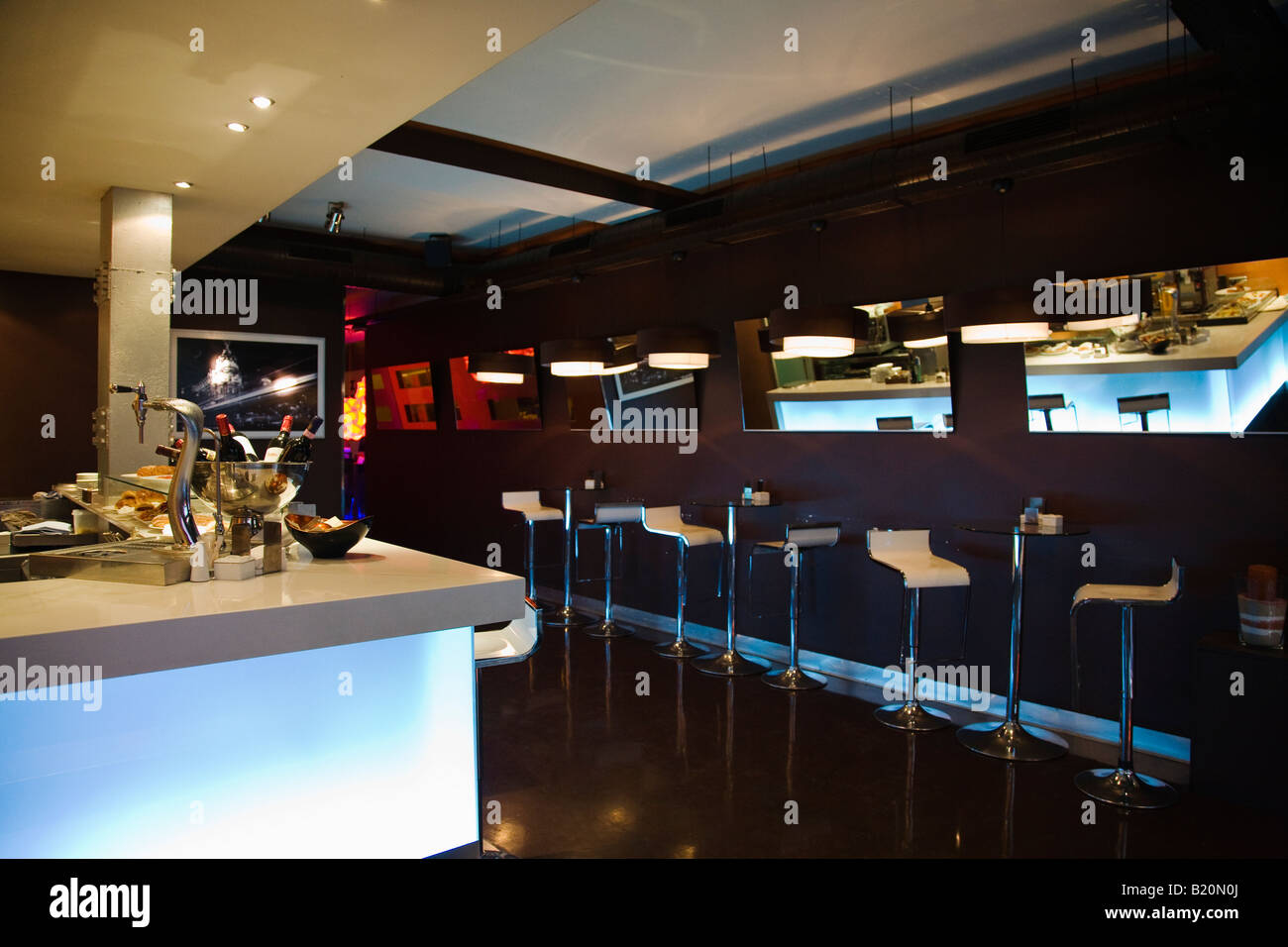 SPAIN Madrid Interior of modern bar with bar stools tables mirrors ...