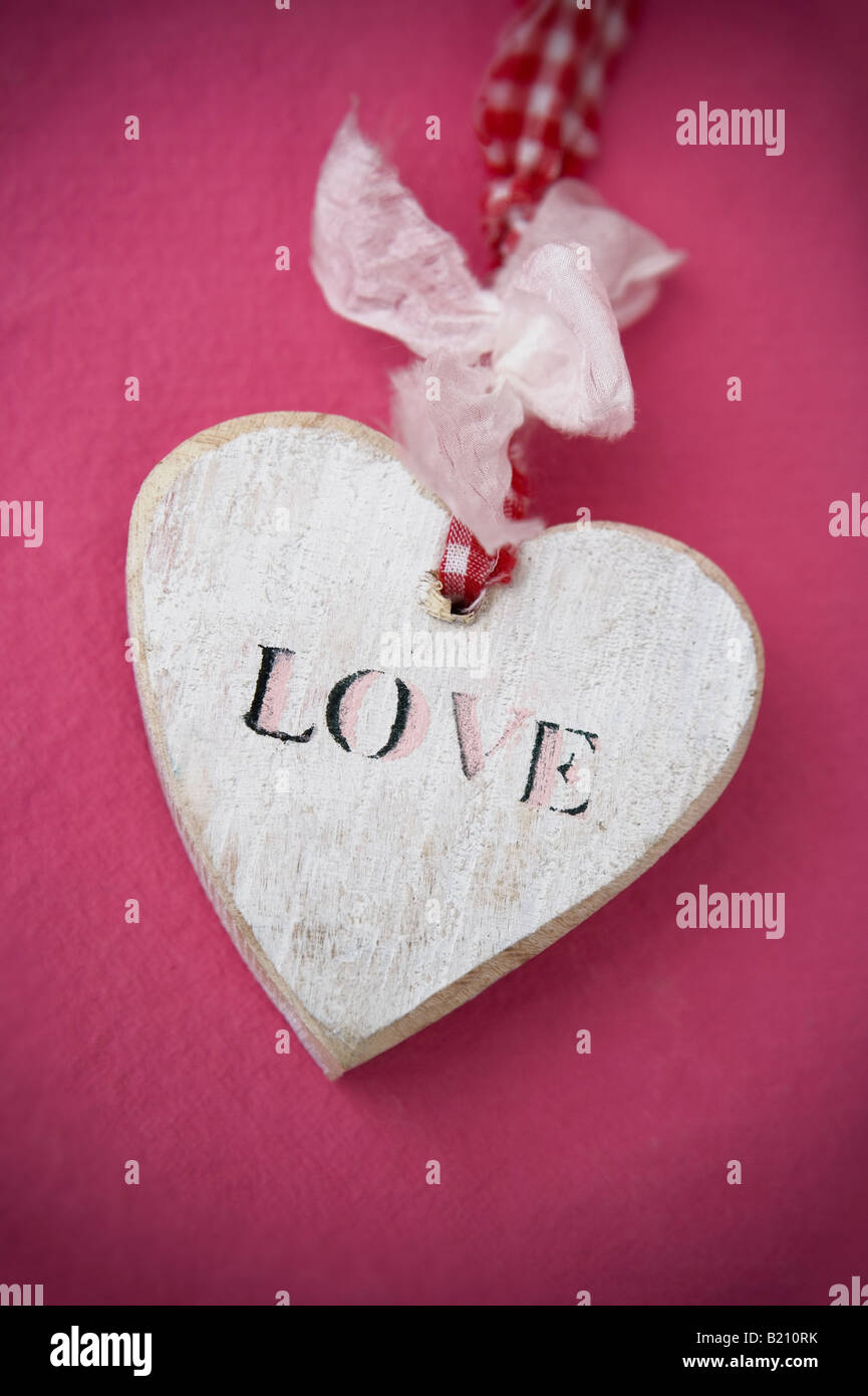 Wooden love heart symbol on coloured background stock photo wooden love heart symbol on coloured background biocorpaavc Gallery