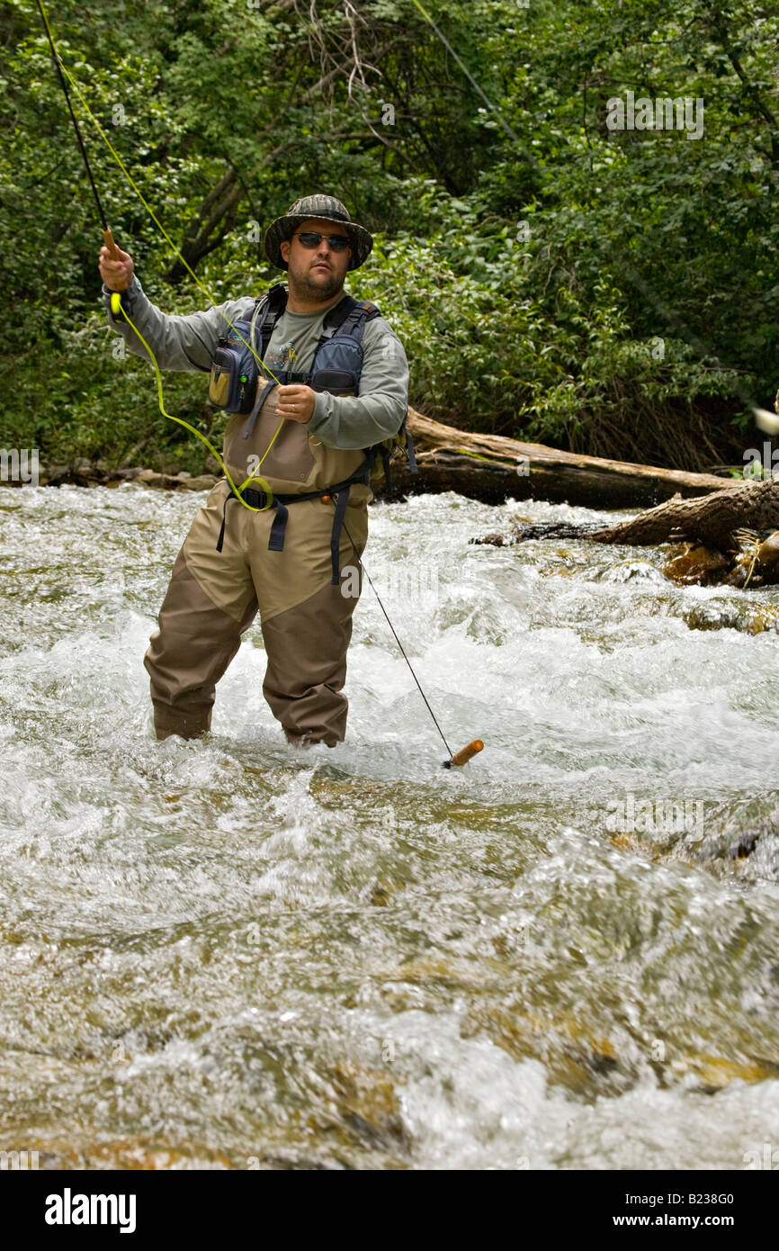 Man fly fishing along the rio hondo near taos new mexico for New mexico fishing