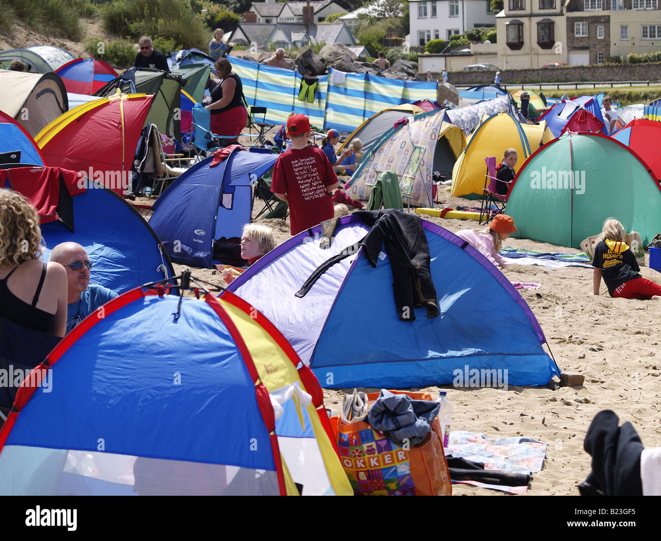 Summerleaze beach Bude Cornwall UK. Crowded with beach tents people and wind breaks on a hot summers day & Summerleaze beach Bude Cornwall UK. Crowded with beach tents ...