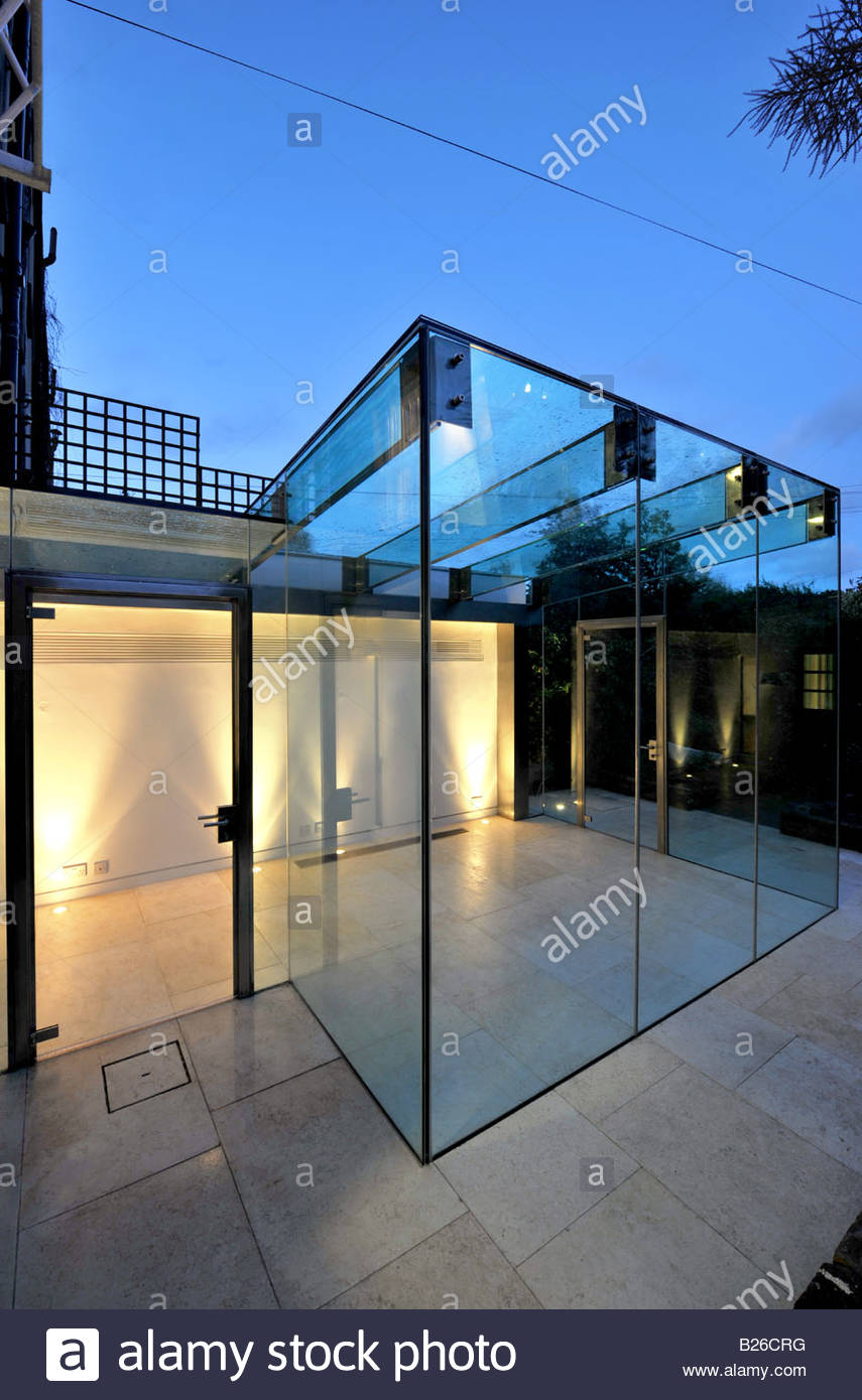 Glass Box Conservatory Extension At Night Stock Photo