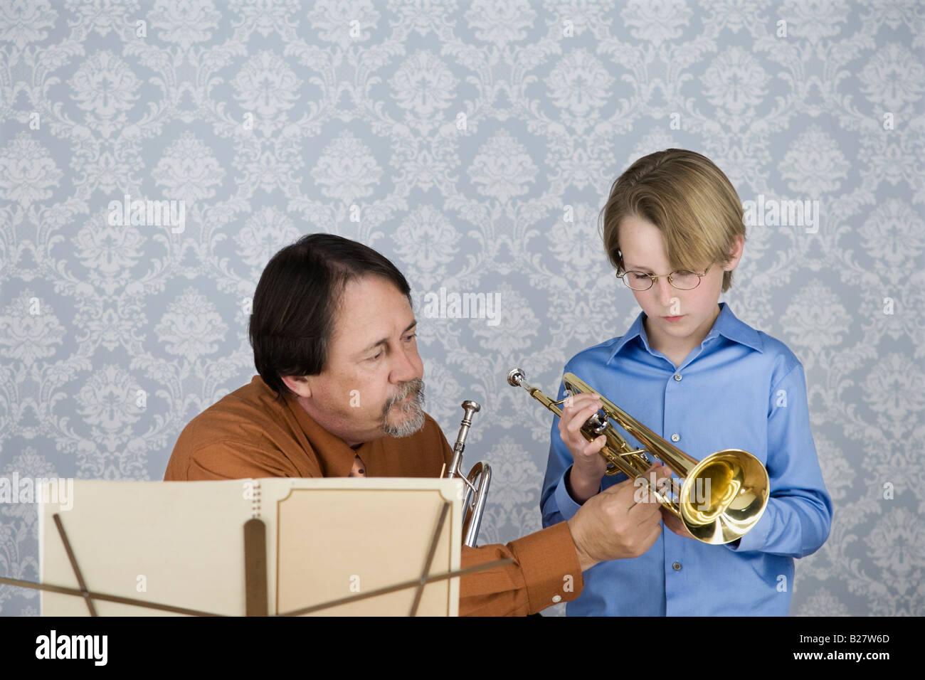 Music teacher teaching boy to play trumpet Stock Photo, Royalty ...