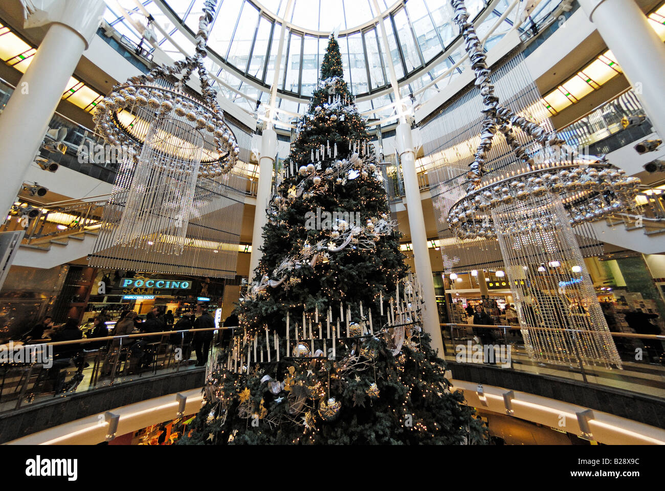 stock photo large christmas tree in shopping mall schadow arkaden in duesseldorf germany - Large Christmas Tree