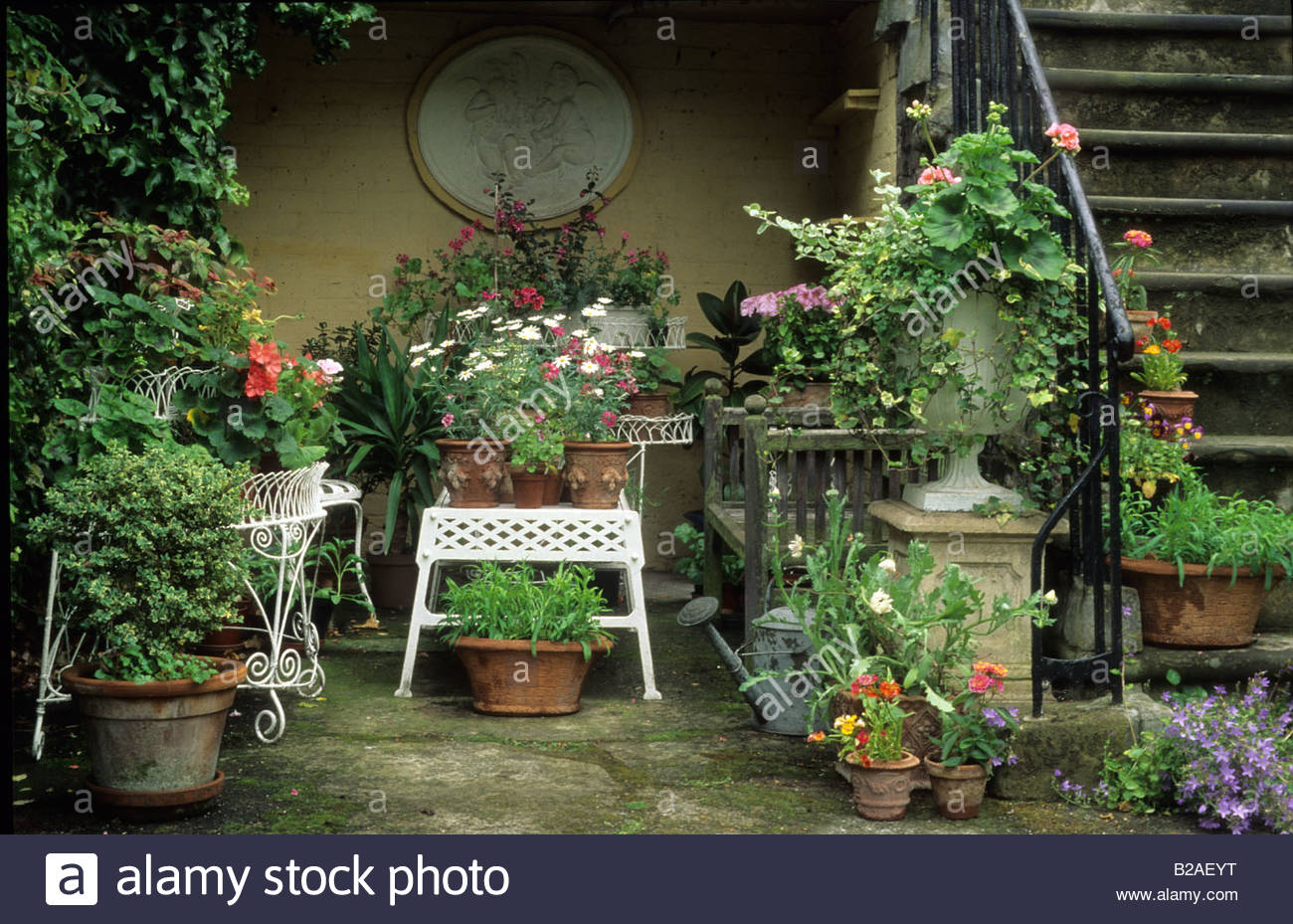 Stock Photo   Private Garden London Seating Area With Potted Plants On Patio