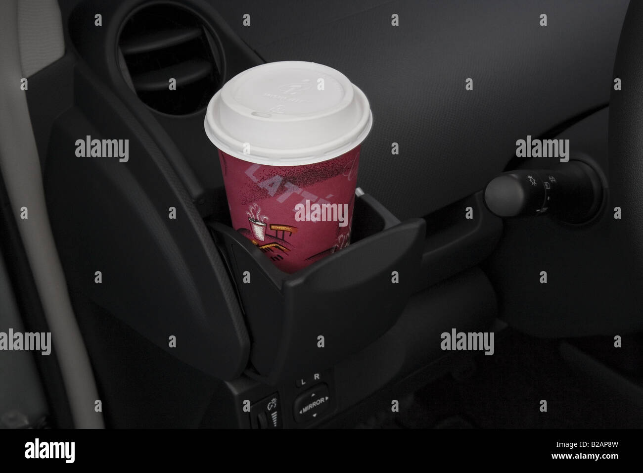 2008 toyota yaris in gray cup holder with prop stock photo royalty free im. Black Bedroom Furniture Sets. Home Design Ideas