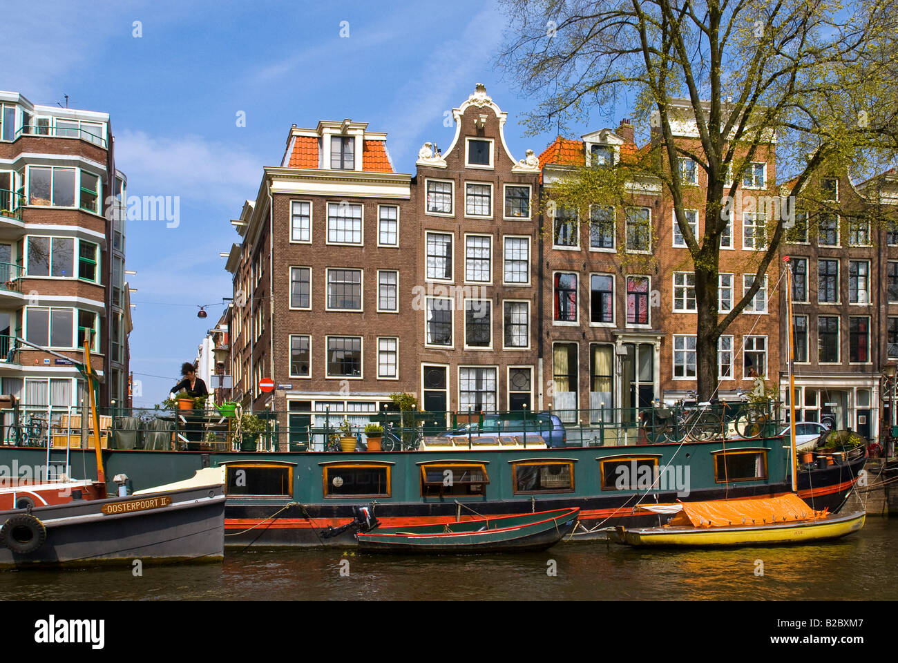houseboats in front of buildings along the canals in amsterdam stock photo royalty free image. Black Bedroom Furniture Sets. Home Design Ideas