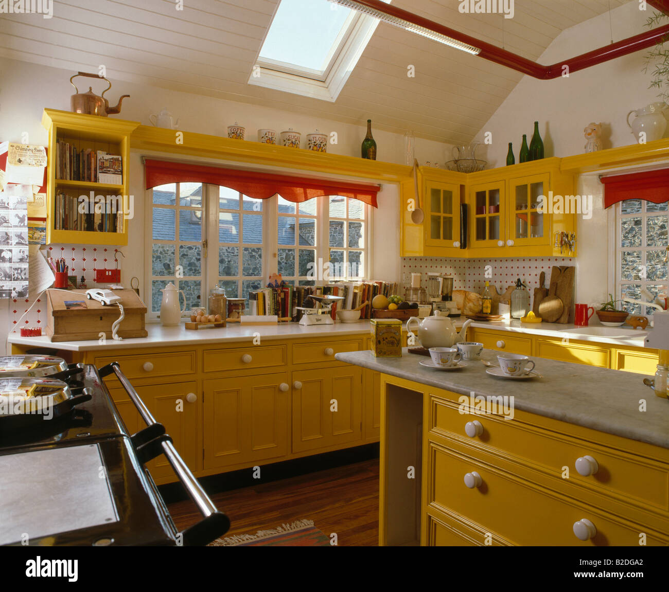 Attic Kitchen Yellow Fitted Cupboard Units In Eighties Attic Kitchen Stock Photo