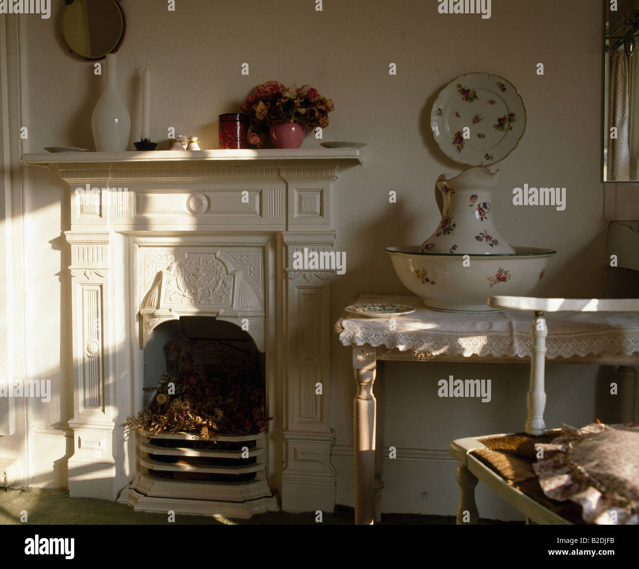 Victorian Bedroom Fireplace Fret : White victorian fireplace in bedroom with large jug and