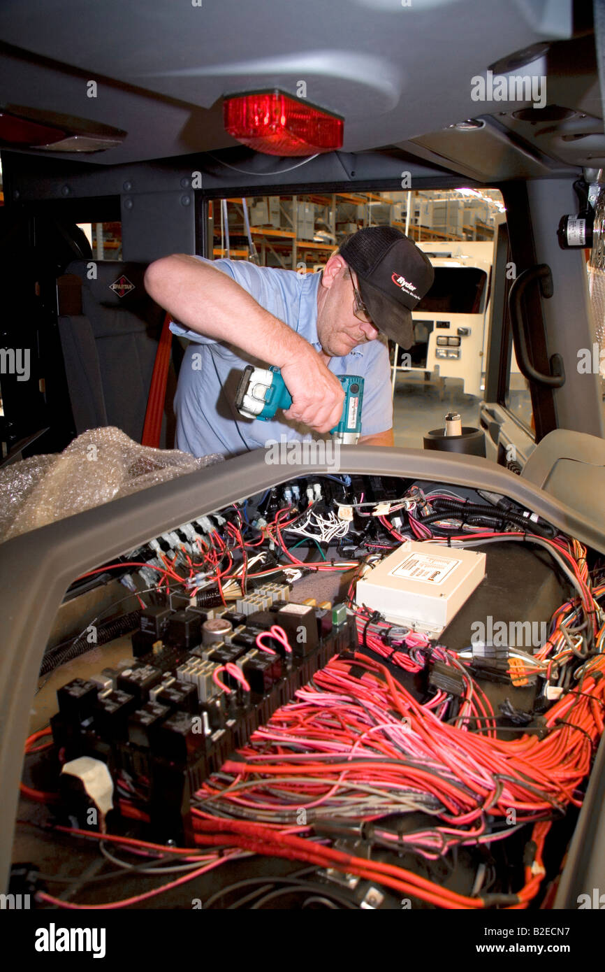 Worker Installing Wiring Into A Newly Manufactured Fire