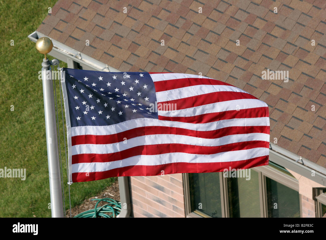An american flag flying on a flag pole viewed from above the house an american flag flying on a flag pole viewed from above the house sciox Image collections