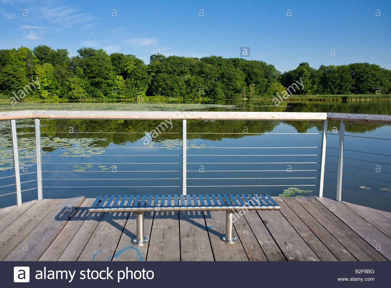 Boardwalk And Bench On Pond In Rouge Beach Area Of Rouge Park In Stock Photo Royalty Free Image