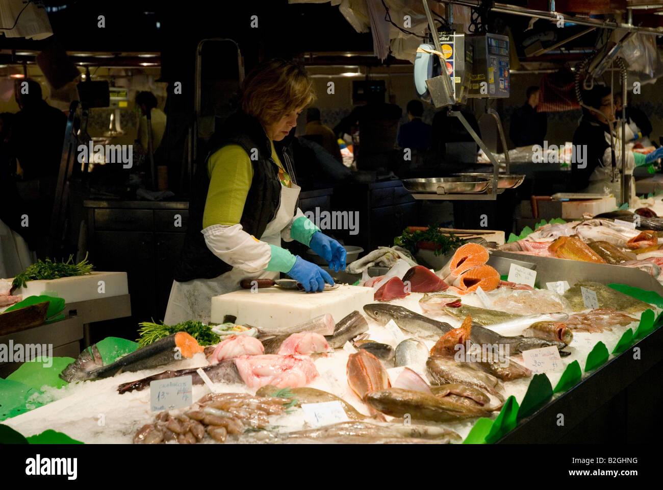 Woman sell fish at la boqueria fish market barcelona spain for La fish market